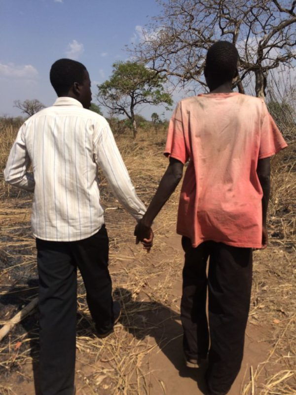 Kenneth walking with Jimmy, escorting us around