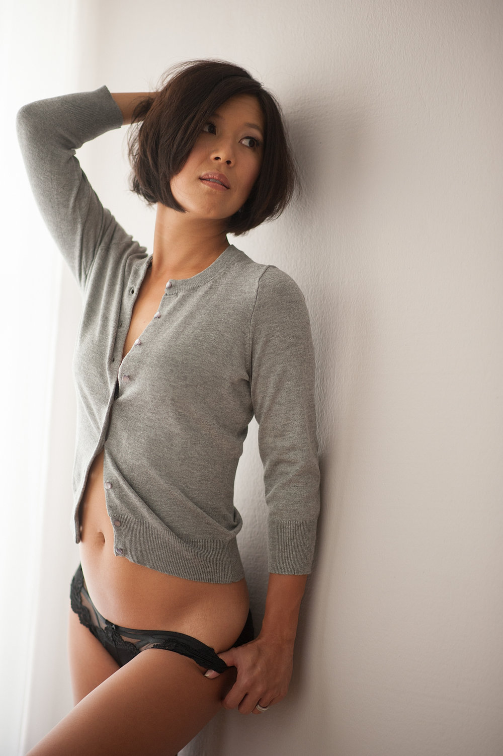 05-sexy-sweater-panties-leaning-wall-pose.jpg