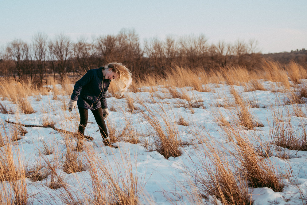 teenage girl in snow and golden grass - Twin Cities Family Photographer