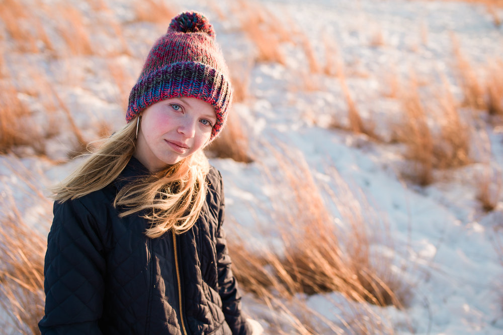 blonde tween girl with purple and blue hat in winter field - orono family photographer