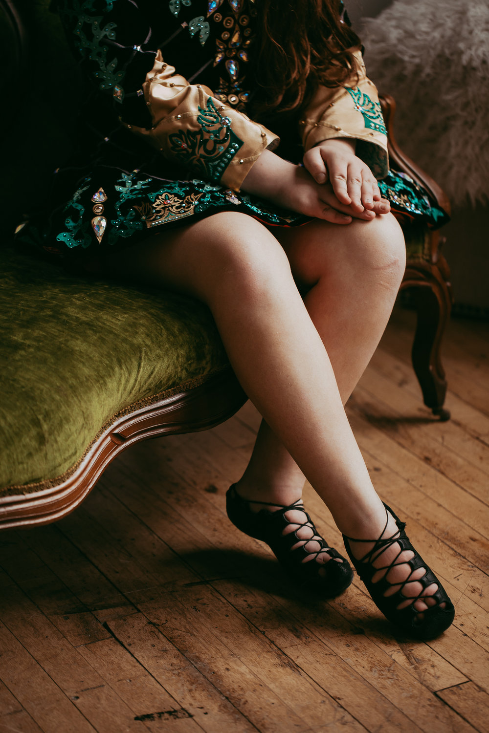 legs of Irish Dancer tying shoes - Twin Cities Artistic Family Photos