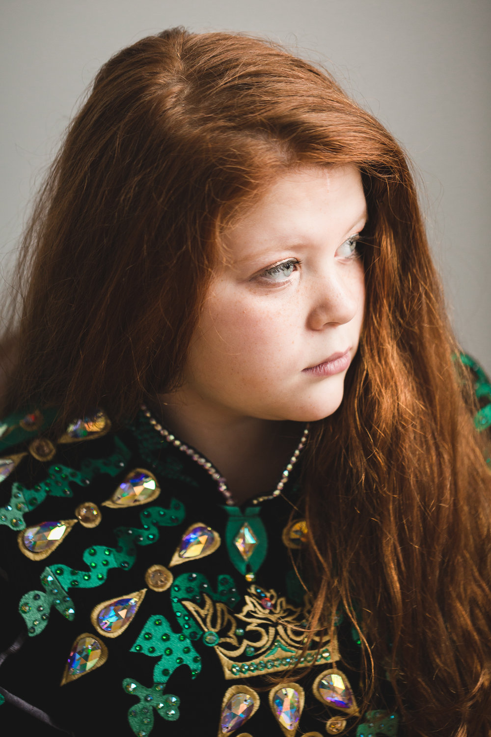 portrait of red haired girl in green dress  - Family Photographer Twin Cities