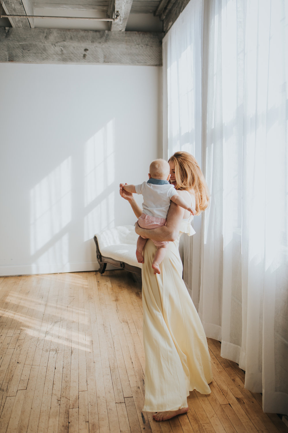 mother dancing with baby boy - Twin Cities Newborn Photographer