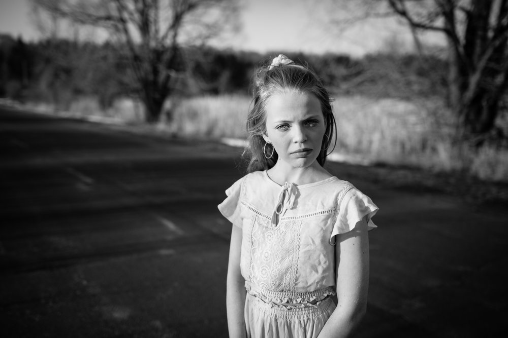 black and white photo of little girl in field - Twin Cities Family Photographer