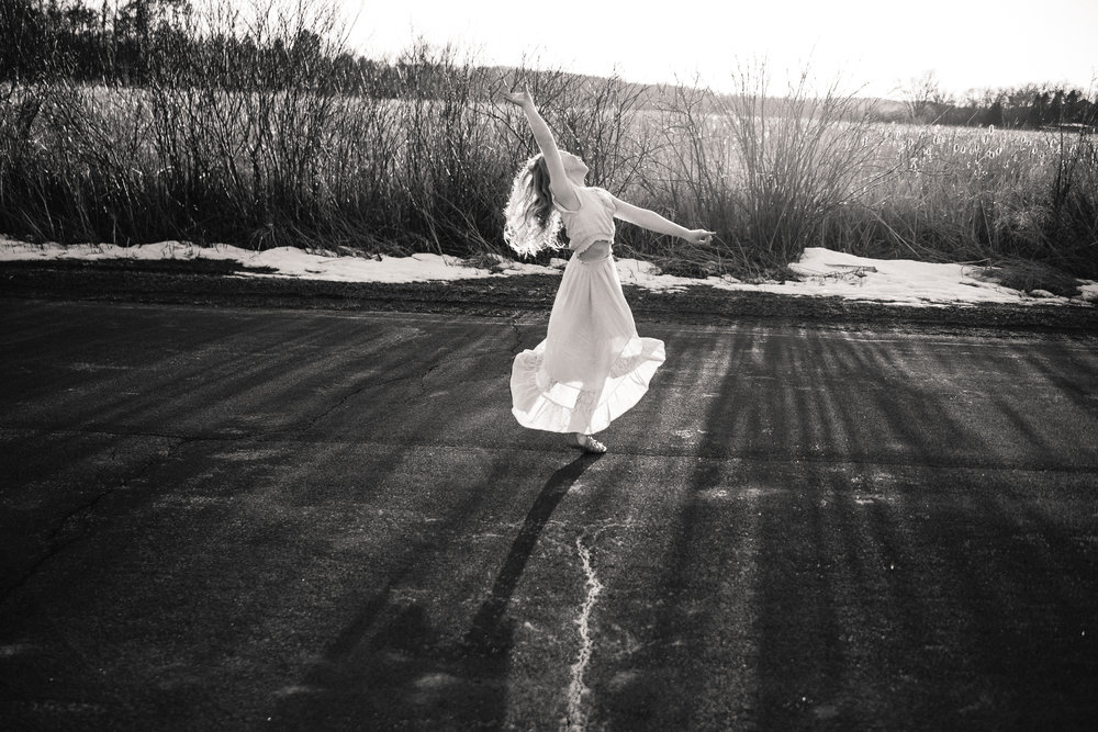 ballerina in white dress spinning in the sunset - Plymouth Minnesota Family Photographer