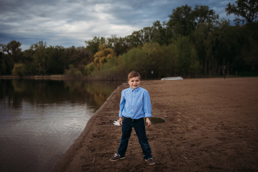 boy in blue smiling on the beach - Twin Cities Child Photographer
