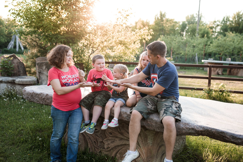 Family playing out side in the sunset - Minneapolis Family Photographer