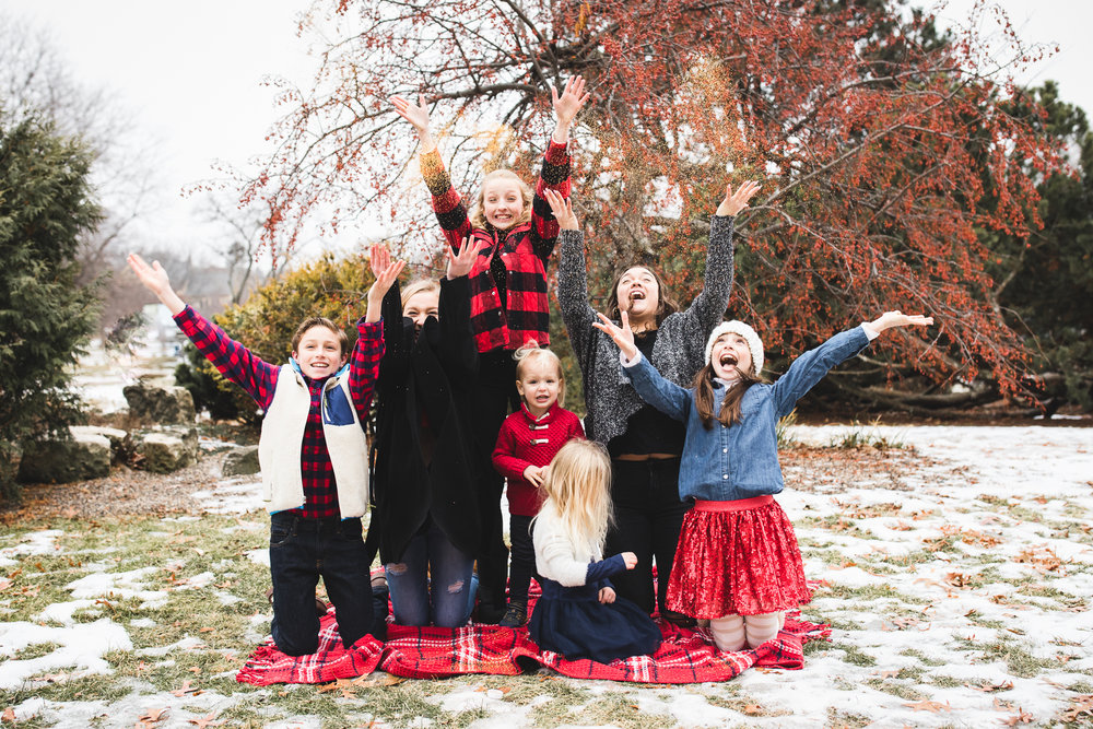 children throwing glitter up in the sky - Minnesota child photographer