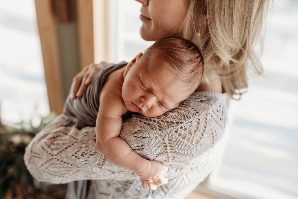 blonde woman cuddling with baby - AMG Photography