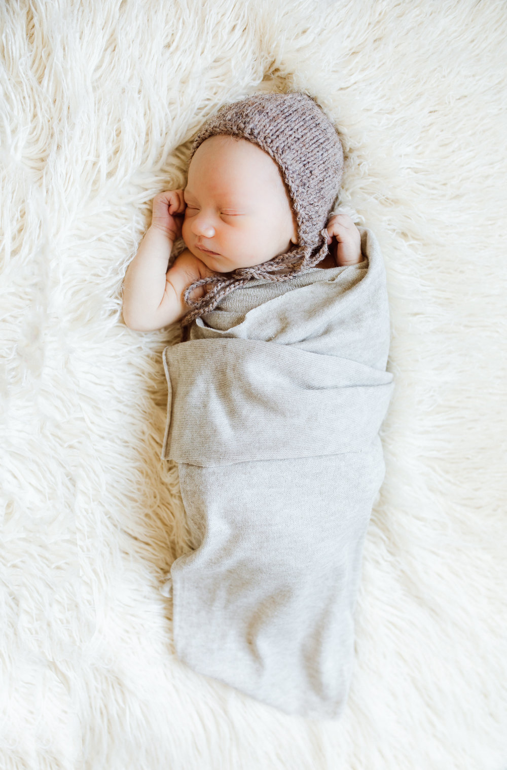little boy sleeping on a white fluffy blanket - Minnesota Newborn Photographer