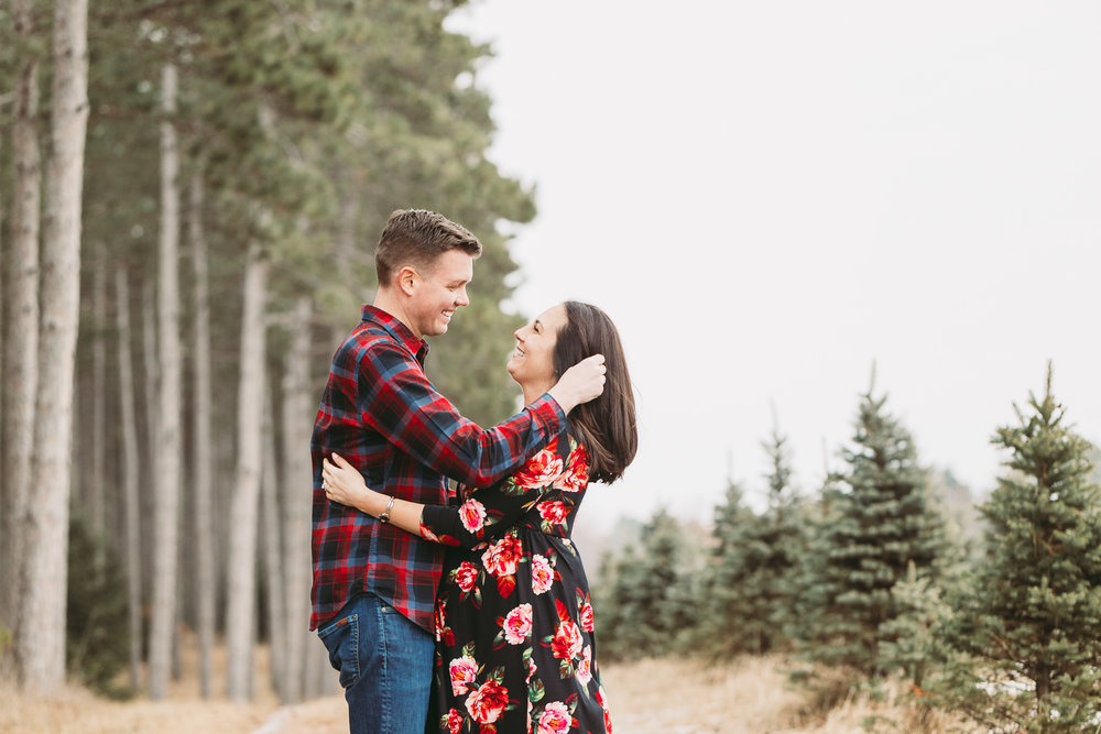 maternity photos of man and woman at a tree farm - AMG Photography