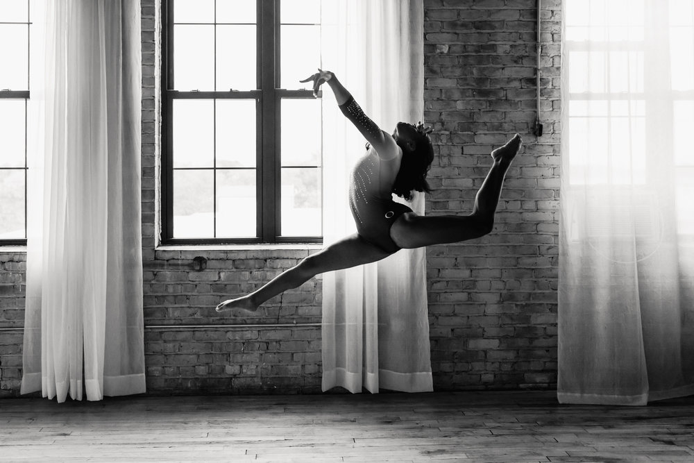 Gymnast leaping - AMG Photography - Minneapolis Senior Photographer