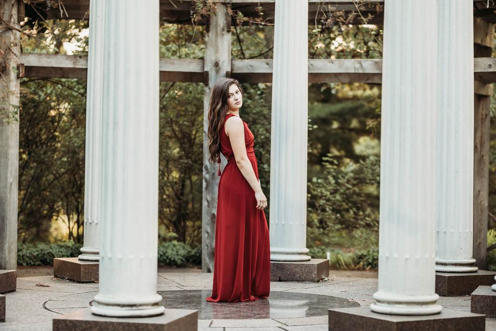 young woman in a red dress in the Noerenberg Gardens in Wayzata | AMG Photography