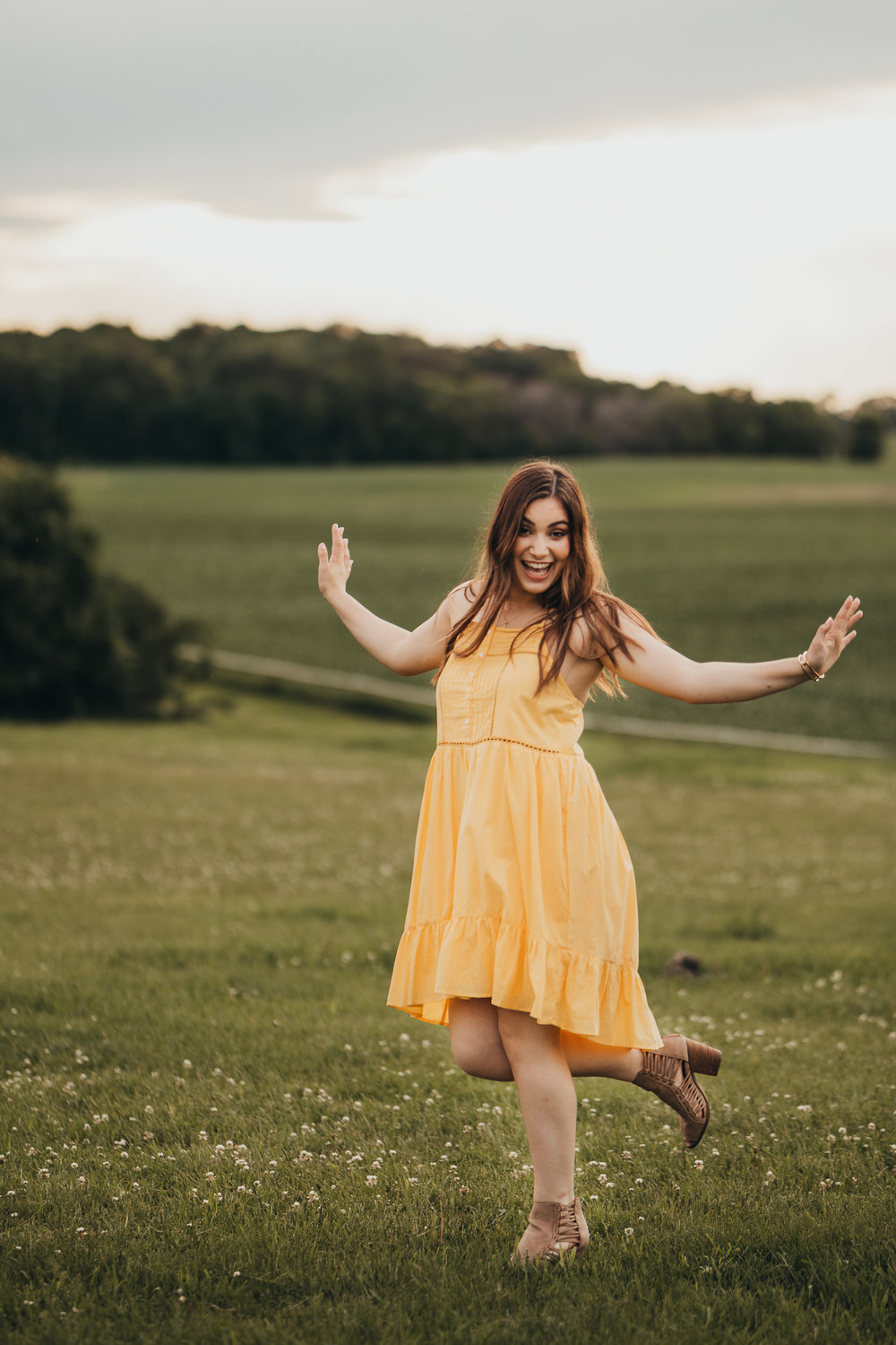 girl dancing in a field with horses - Eden Prairie Senior Photographer - AMG Photography