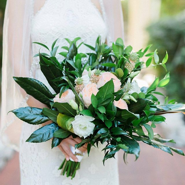 Another one of our favorites! A gorgeous mix of greens, peach roses, white lisianthus and mini pineapples. ⠀ 💐@loveinbloomkeywest⠀ 📸@bettylavryk⠀ •⠀ •⠀ •⠀ •⠀ #keywestwedding #destinationwedding⠀ #luxurywedding #weddingday  #weddingplanner ⠀ #weddingplanning #weddingcoordinator ⠀ #luxuryweddingplanner #destinationweddingplanner #weddingplannerlife⠀ #weddingvibes #eventdesign #weddingstylist #weddinginspo #weddinginspiration #weddingideas #weddingdecor #soireekeywest #lifeofaweddingplanner #instawedding⠀ #igerswedding