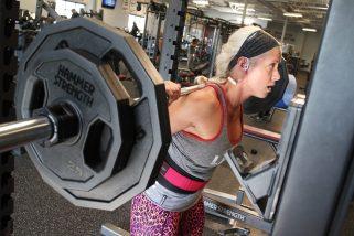 Lindsay Armell doing squats in the free weight section.