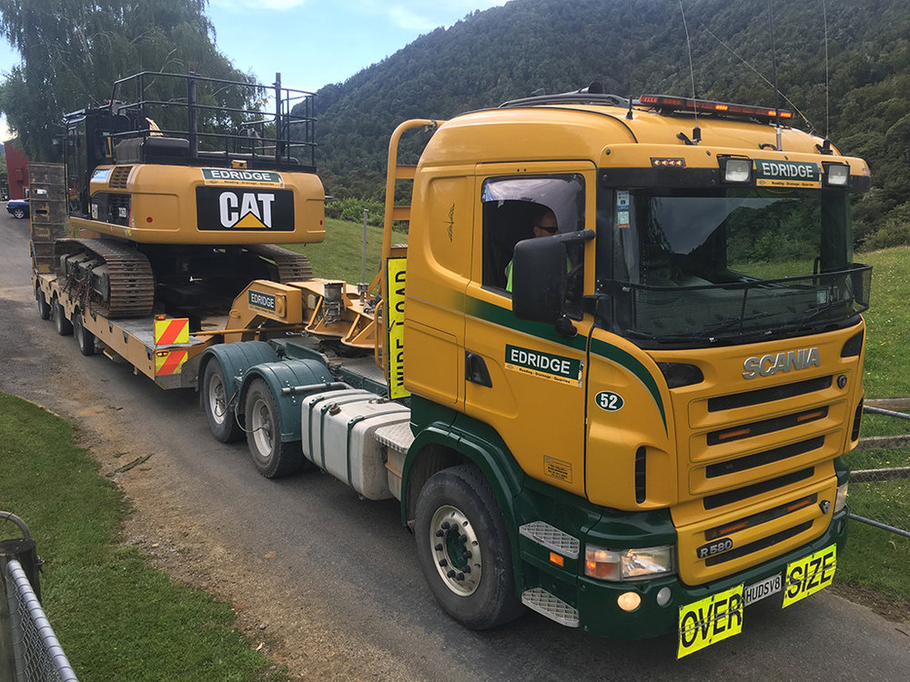 Loaded up and leaving the Yard at Pelorus with the 336DL excavator