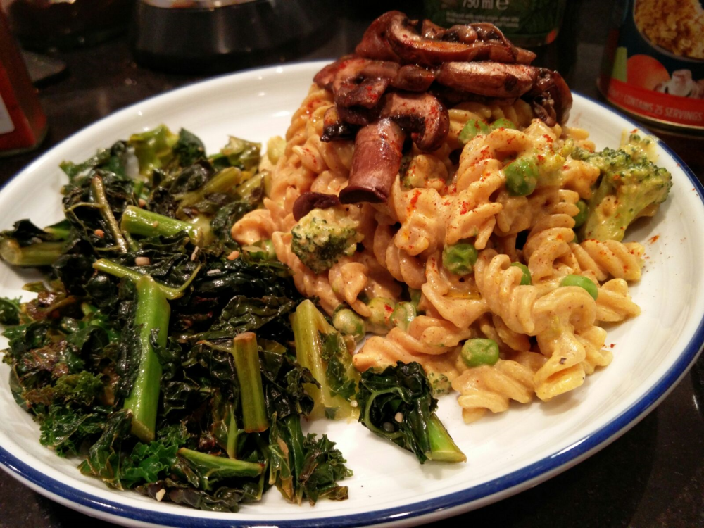 Cheesy Pasta with Mushrooms & Sautéed Kale. I like to cook my greens in a bit of coconut oil, garlic and then squeeze lemon over the top. So bloody tasty!