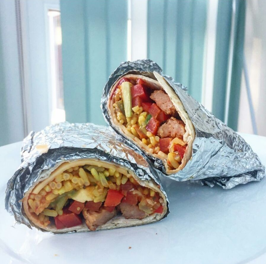 BURRITO loves rejoice! This is a fat ass burrito using  Linda McCartney  Sausages, Mexican Rice, Avocado, Spicy Red Pepper Sauce in a Garlic & Herb wrap - Photo taken from  the.hangry.vegan