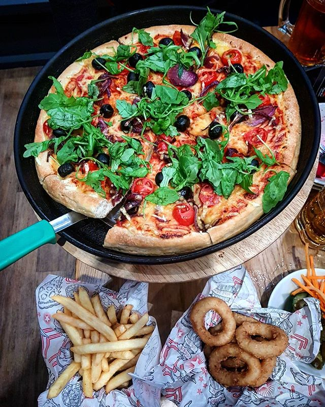 "🍕 P I Z Z A  H U T🍕 A few weeks ago we went to @pizzahutuk to try out their vegan options! We opted for a Heavenly Veg swapping the Goats Cheese for the @violife_foods on a Pan Base.  This was the sharing option that was about 13"" for £18ish. We also got some Fries and Onion Rings and filled up on the Salad Bar without checking what was vegan & missing out on loads (swipe for the options off their website which does include cous cous!) The sides may not be vegan in all stores so do check, and they may be cooked in the fryer with the Jalapeño Poppers which contain cheese (which isn't a problem imo) 🍟  Pizza tasted good but to be honest I prefer the other chains as I like a thin base (you can get one at pizza hut too - see the 3rd pic for vegan bases) which IMHO is tastier and has better topping options. Plus you're not paying extra for vegan cheese! 💸 ➡️ ➡️ Tip: Get 2 pizzas each rather than sharing and if you don't eat it all, take it home! Much better value for money 💰💰 I have to say though the staff were friendly and despite feeling like the oldest person in pizza hut, it's absolutely fantastic to be able to have these options in store 👍 ... #pizza #veganpizza #pizzahut #pizzahut🍕 #vegansneedpizzatoo #vegancheese #violifecheese #violife #pizzatime #pizzalovers 🍕🍕🍕 ... #veganfoodporn #tastyveganfood #veganfoodshare #vgang #vegansofmanchester #vegansofinstagram #ukvegan #vegansuk #manchester #manchestervegan #mcrvgn #manchesterfoodie #instafoodie #deliciousfood #manchesterblogger #veganblogger #blogger #easytobevegan #definitelyvegan 💚✌️🌱"