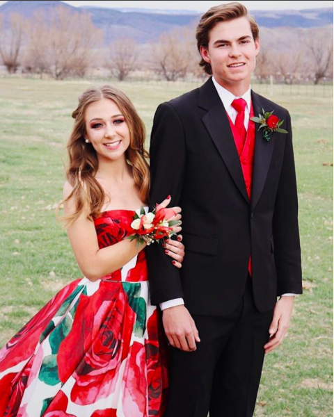 "THIS. PRINT. You guys, the giant red rose floral is amazing!  One of Sherri Hill's signature looks this season and Maleea is absolutely rocking it.  About Prom this year, she said, ""For once, everything was perfect.  My school had been going through a ought time period in the weeks leading up to Prom; everyone was down and life had lost its lust.  However, Prom was an escape from all this! A night where everyone truly felt and looked beautiful: a night of joy and laughter.  Prom was simply a night to remember."""