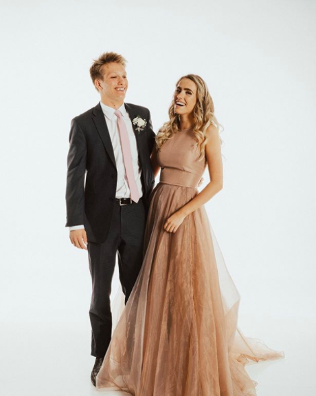 "Oh this champagne color paired with an iridescent flowy skirt! Kaitlyn looks amazing, and commented that ""My dress made me feel like a Princess, and I was surrounded by my closest friends! It was an experience I'll never forget!"""