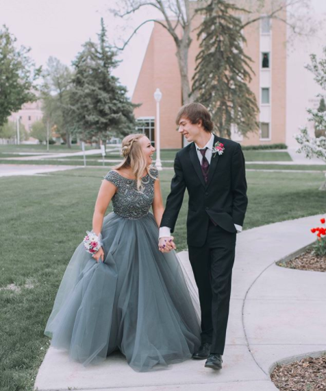 Charcoal grey is always a stand-out favorite color amongst our staff, and you can see why!  This color looks fantastic on Lexie and we love the tulle ballgown paired with a detailed beaded bodice. Thanks for shopping with us, Lexie!