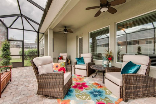 If the great outdoors is more your style, check out this perfectly screened-in back patio and paver-covered porch. You'll spend every morning out here drinking coffee, and every evening grilling on the BBQ.