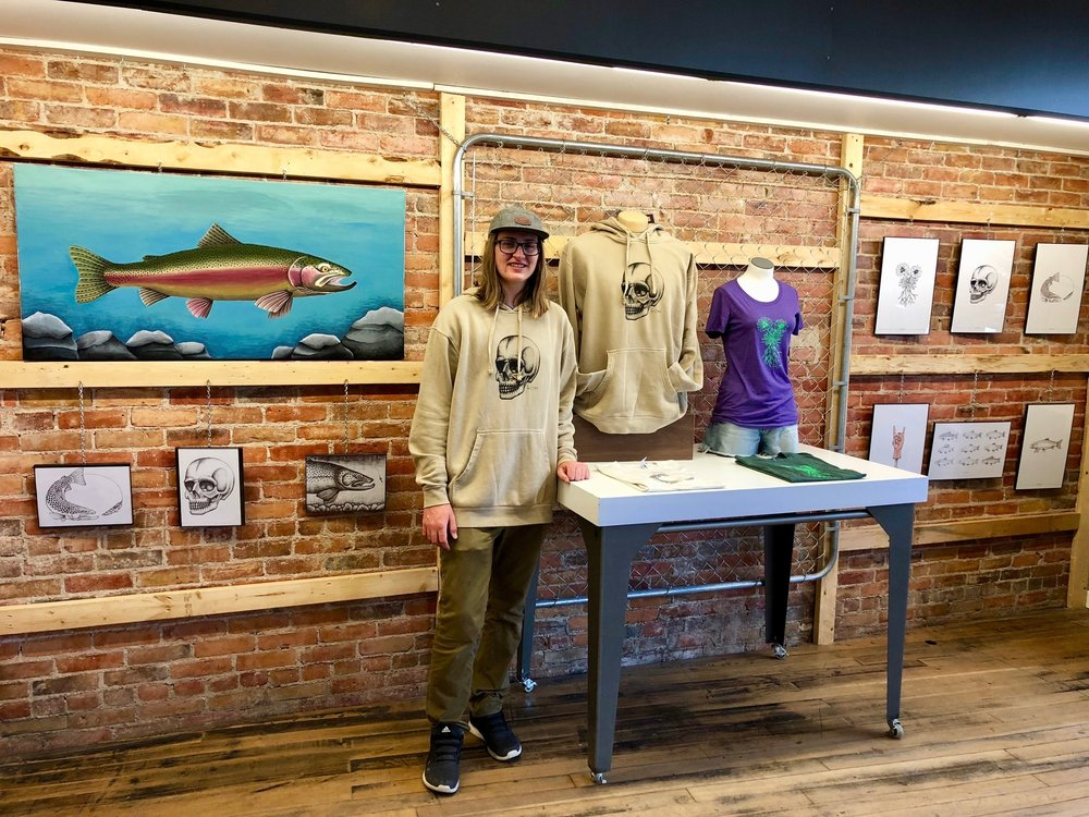 Isaac Fisher showcasing his artwork & fourOsix artist series goods