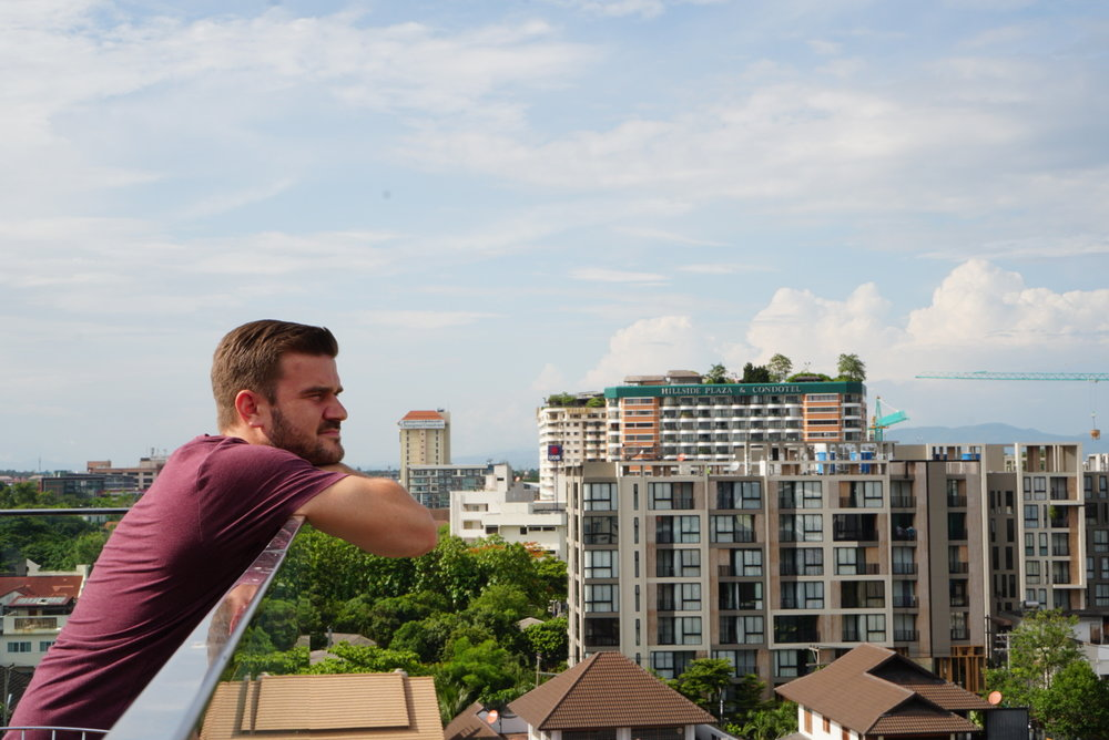 Chiang Mai Thailand, Sal overlooking the city on the Akyra Manor Rooftop.