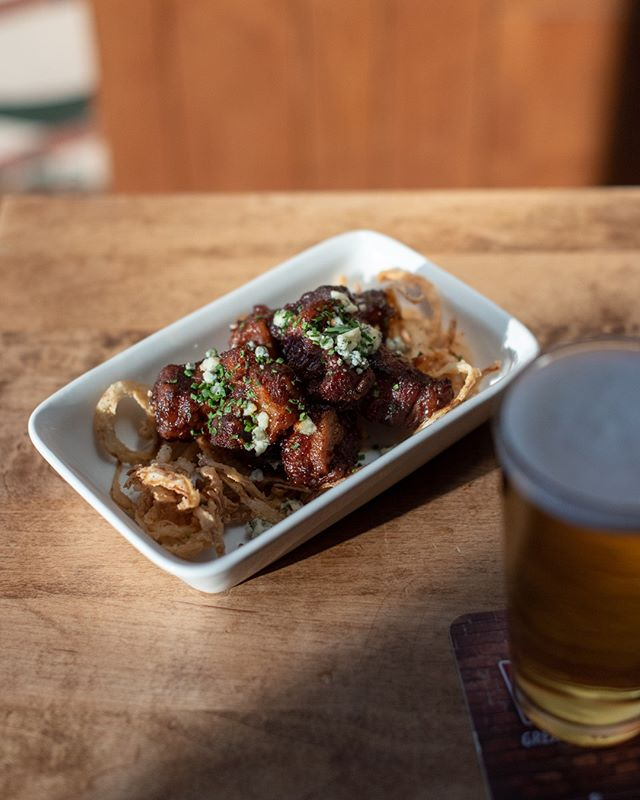 "Wondering wtf the ""Burnt Ends"" on our new menu are? They're actually smoked pork belly cubes with a hot honey glaze, topped with blue cheese, fried onion, and chives."