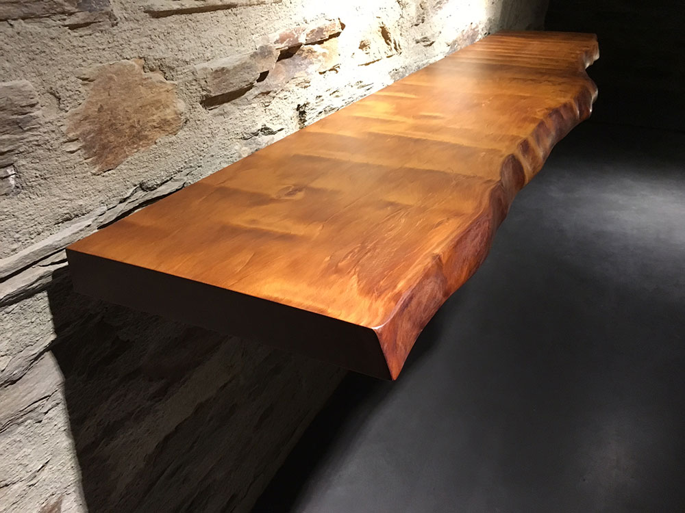 Treology Ancient swamp kauri live edge slab console on schist stone wall for Emerald Bluffs house, Wanaka NZ
