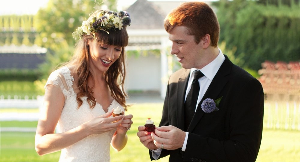 Bride and Groom with cupcakes wider.jpg