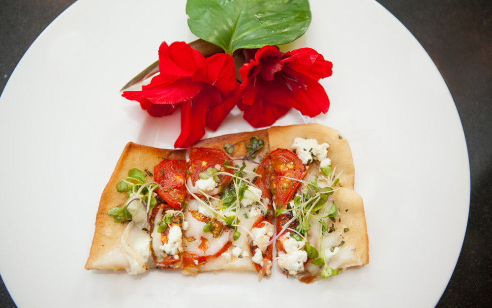 Rosemary Thin Crust Pizza, Mozzarella Cheese Goat Cheese, Roasted Tomatoes Basil, Micro Greens Lemon Vinaigrette