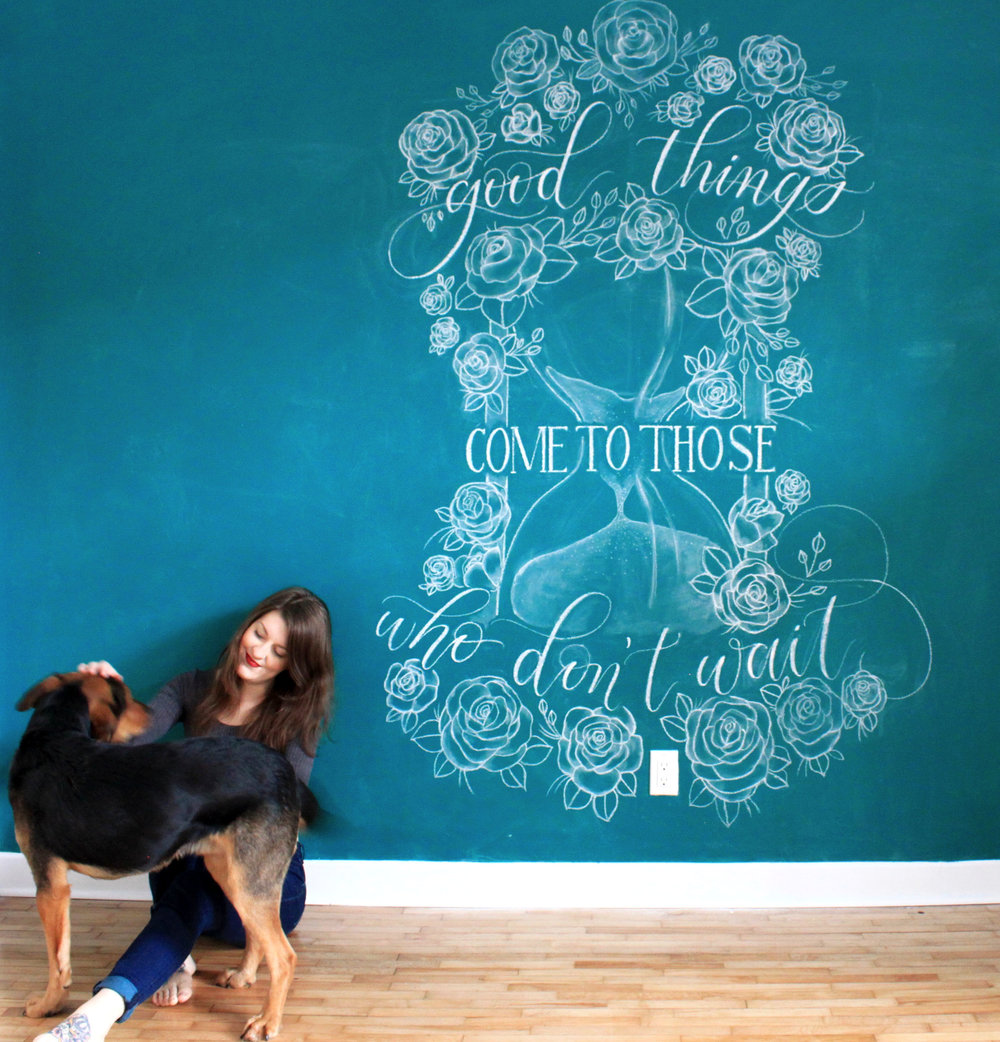 A Chalkboard Mural, featuring a mixed design of calligraphy, typography and floral illustration, in my home studio.