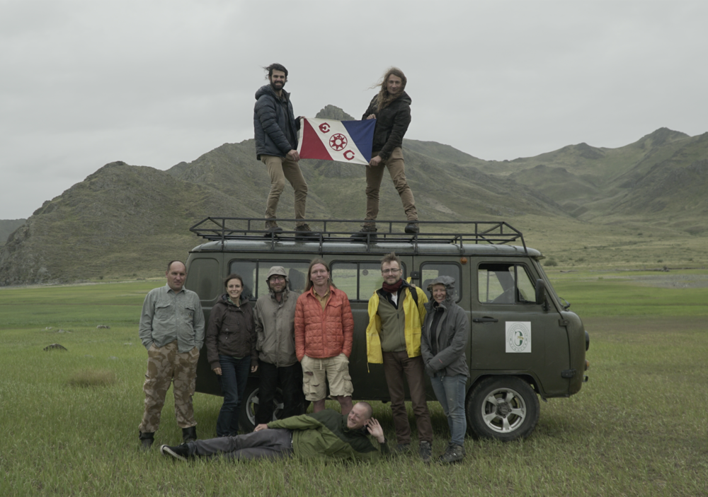 In the summer of 2017 Gino received his PhD and lead his first expedition to Siberia resuming their search for an intact Scythian tomb. He assembled a team of archaeologists from the Hermitage Museum and the Russian Academy of Sciences in St. Petersburg, Russia. Here is the team with Explorers Club Flag #134. [Top to Bottom-Left to Right] Trevor Wallace  (expedition filmmaker)  Dr. Gino Caspari  (expedition leader)  Anatolie Luboshnikov  (driver)  Valeria Makarova  (volunteering archaeologist)  Maxim Eltsov  (soil scientist)  Timur Sadykov  (Russian expedition leader, license holder)  Jegor Blochin  (technical lead)  Katarzyna Langenegger  (volunteering archaeologist)  Jegor Mazurkievich  (cook) Not pictured:  Kezhik Mongush  (student)