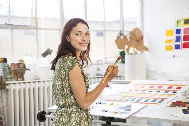 female-artist-working-on-abstaract-painting-181034944.jpg