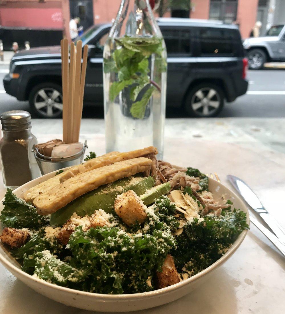Vegan kale caesar salad with tempeh