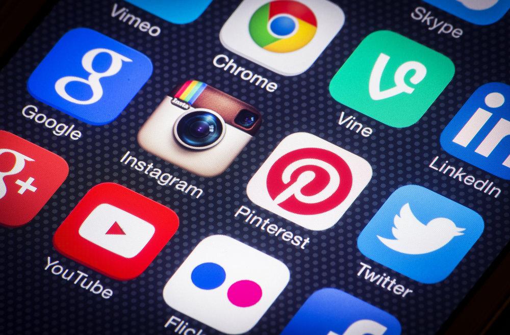 bigstock-Social-media-icons-on-smartpho-60749672.jpg