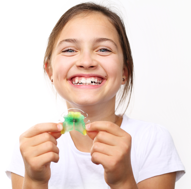 signs your child might need orthodontic treatment.png