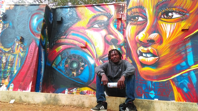 Kaymist4 (Kenya)    Kenneth Otieno ,  popularly known as Kaymist4, attributes his passion for the arts as having had a positive impact in his life. The quiet soul,is a founding member of the well-known Graffiti Crew BSQ, hailing from the streets of Nairobi.    Kaymist loves to play around with the African physique and combines this with his curiosity for technology.Focusing on African people and technological future events, he add's mechanical features (bolts, screws and gears) to their bodies. He developed this Afro-future 'kind of view'.  His main mediums of work include, spray paints (aerosol), oil, acrylic paint on canvas, and wood carvings, with these he creates street art, murals and jewellery. This will be Kaymists' first visit to Australia.
