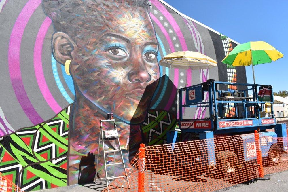 Sanaa Street Art collaboration, Kenyan artist Bankslave with Australian artist Joel Van Moore