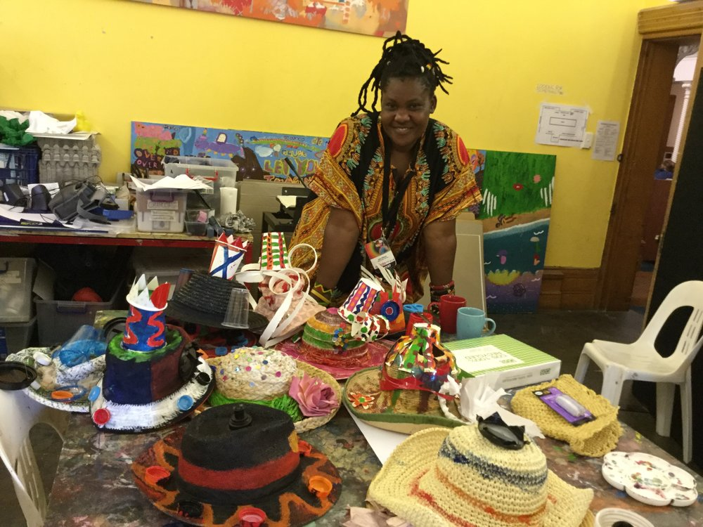 Kenyan artist Joanne Otieno used recycled materials to create hats with a class from Adelaide Secondary School of English.