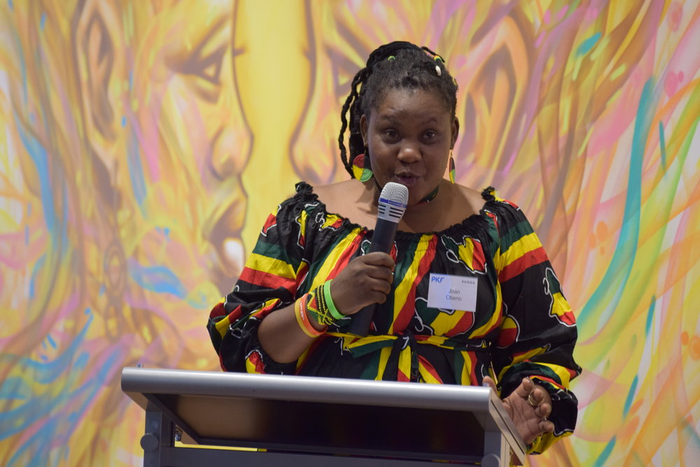 Kenyan artist Joan Otieno shares her story at a Sponsor event on International Women's Day.