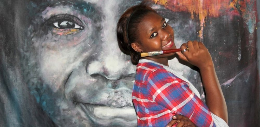Mwamba-Chikwemba-with-one-of-her-large-format-paintings-photo-via-andrewmulenga-blogspot-rs-.jpg