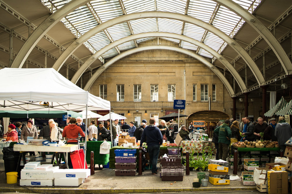 The popular Bath Farmers' Market which runs every Saturday from 8am - 1.30pm. Local farmers, producers and traders from Bath and Somerset sell meats, veg, cheeses, apple juice, free from produce, cakes, breads, olives and more.