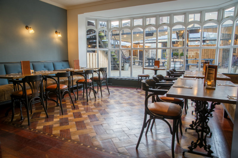The sun room is a lovely dining space, with comfortable booth & armchairs. Perfect for lounging with a pint, the papers or listening to great live music - We take bookings