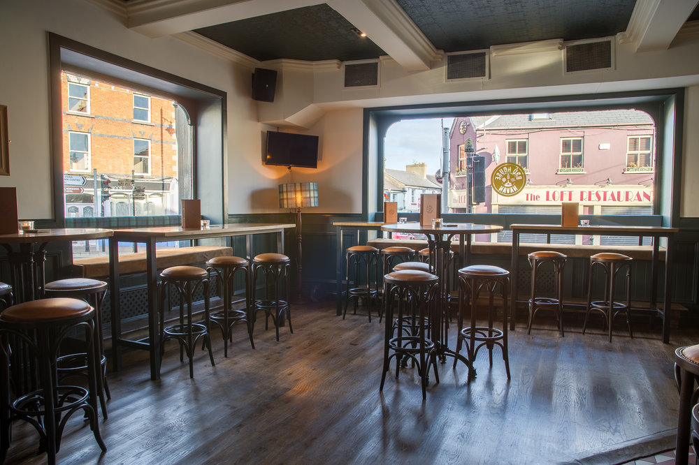 BRÚ House front barOur main bar area with large windows, polished floors and high seating. The perfect spot for a pint of BRÚ. - Brew's Hill, Navan