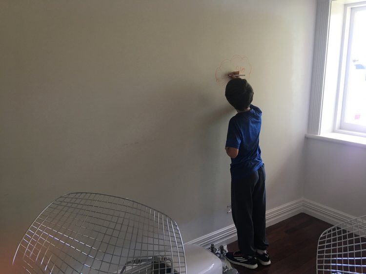 (My son decorating the walls of the Studio Room)