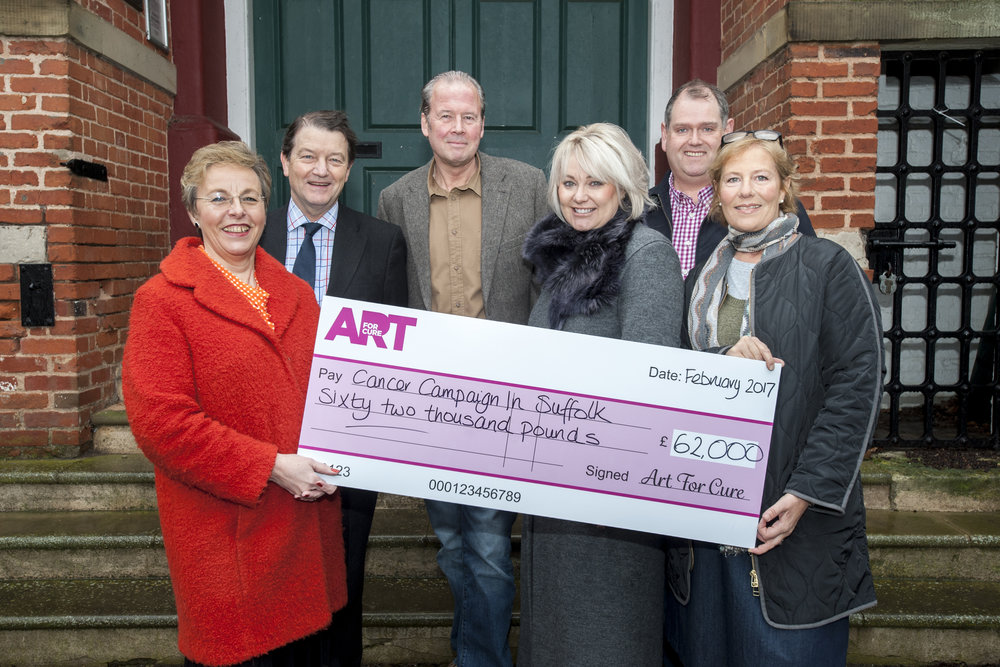 Cheque presentation, from left to right: Karen Hare, CEO CCiS, Tim Cutler and Jonny Ripman , Trustees of CCiS, Emma Lloyd, Adrian Melrose and Belinda Gray, all Directors of Art For Cure.